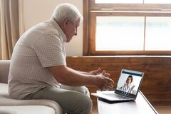 Elderly man have video call with doctor at home
