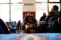 Elderly men in a turkish tea house. Seniors talk in a traditional tea house in Goreme, Turkey. Turkey had the highest per capita tea consumption in the world, at Stock Image