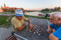 Elderly mens play chess on the embankment of Vistula Royalty Free Stock Image