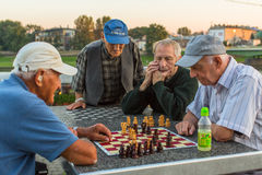 Elderly mens play chess on the embankment of Vistula Stock Image