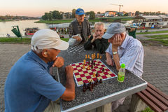 Elderly mens play chess on the embankment of Vistula. Royalty Free Stock Photos