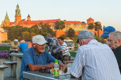 Elderly mens play chess on the embankment of Vistula. Stock Image