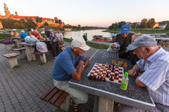 Elderly mens play chess on the embankment of Vistula. Royalty Free Stock Photo