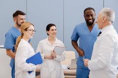Elderly mentor enjoying teaching interns in medical university royalty free stock photos