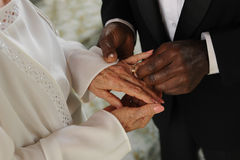 Elderly mixed couple exchanging wedding rings Royalty Free Stock Photo
