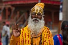 An elderly monk at Durbar Square in Kathmandu royalty free stock photos