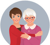 Elderly mother and adult daughter Stock Images