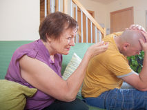 Elderly mother and adult son in quarrel. Quarrel between an elderly mother and adult son Royalty Free Stock Photos