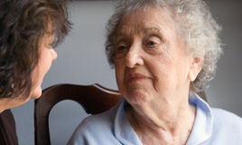 Elderly Mother and Daughter. Elderly mother and her daughter talking Stock Photos