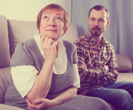 Elderly mother and son quarrel Royalty Free Stock Photography