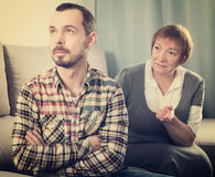 Elderly mother and son quarrel. With each other and find out relationship Stock Photos