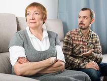 Elderly mother and son quarrel. Mature mother and son quarrel with each other and find out relationship Royalty Free Stock Photo