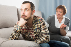 Elderly mother and son quarrel Royalty Free Stock Image
