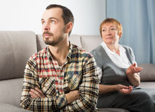 Elderly mother and son quarrel Stock Images