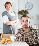 Elderly mother teaches her son Stock Images