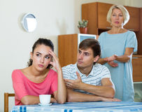 Elderly mother and young man blaming girl in something. Offended young women listening to rebukes from mother and husband Royalty Free Stock Image