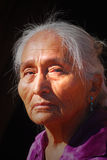 Elderly Navajo woman. With light shining on her face Royalty Free Stock Photography