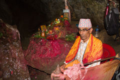 Elderly Nepali priest in a cave in Pokhara, Nepal Stock Photos