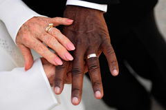 Elderly newlyweds hands and rings Stock Photography