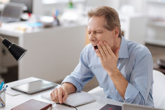 Elderly office worker having toothache royalty free stock images