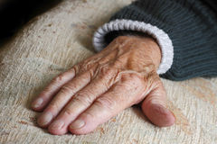 Elderly old persons hand. Palm down Royalty Free Stock Photography