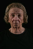 Elderly Old Woman on Black Background Royalty Free Stock Images