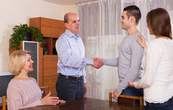 Elderly parents meeting girlfriend of their son. At home Royalty Free Stock Photos