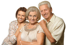 Elderly parents and their adult daughter Stock Photo
