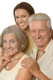 Elderly parents and their adult daughter Stock Image