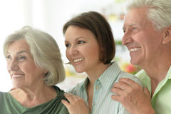 Elderly parents and their adult daughter Royalty Free Stock Photo