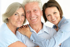 Elderly parents and their adult daughter Royalty Free Stock Image