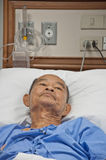 Elderly patien in hospital lay on the bed Royalty Free Stock Images