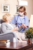 Elderly patient and caregiver Stock Photo