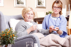 Elderly patient and caregiver Stock Images