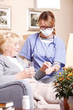 Elderly patient and caregiver Stock Photos