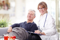 Elderly patient and female doctor Stock Photography