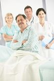Elderly patient with medical team Stock Photography