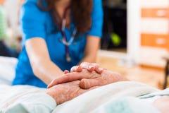 Elderly patient in need Stock Images