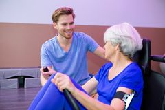 Elderly patient on physical therapy. Physical royalty free stock photos