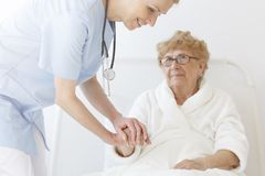 Elderly patient in robe Royalty Free Stock Image