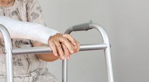Elderly patient waiting on her walker Royalty Free Stock Photos