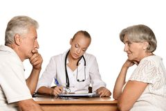 Elderly patients couple came to visit a doctor Royalty Free Stock Image