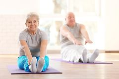 Elderly patients training in rehabilitation center royalty free stock photo