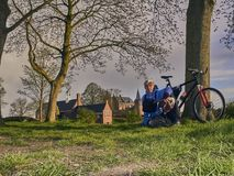 Elderly pensioner on a bicycle travels to. The castle royalty free stock photo