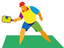 An elderly pensioner plays in a pickleball, in a game. With a racket and a ball with holes Royalty Free Stock Photos