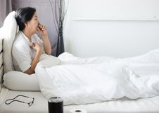 Elderly people asian woman coughing and sitting on her bed,Female sore throat,Concept of health stock photography