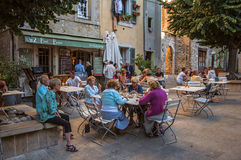 Elderly people in bar in the late afternoon in Vence. Vence, France - July 13, 2016. Elderly people in bar in the late afternoon in Vence, a stunning medieval stock images
