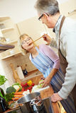 Elderly people cooking Royalty Free Stock Image