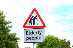 Elderly people crossing sign Royalty Free Stock Images