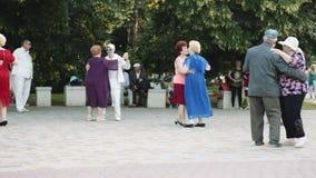 Elderly people dancing in the Park. ARMAVIR, RUSSIA - MAY 31, 2017: Elderly people dancing in the Park to the music of street orchestra stock video